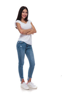 confident brunette woman standing with arms crossed
