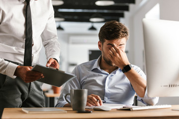Image of Tired business man having problems in work