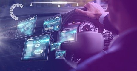 Man driving in car with heads up display interface
