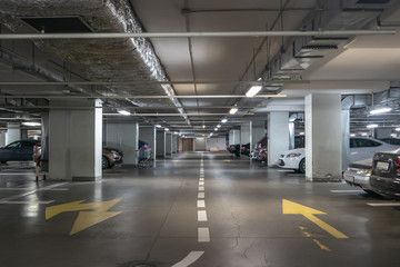 Underground garage or modern car parking with lots of vehicles