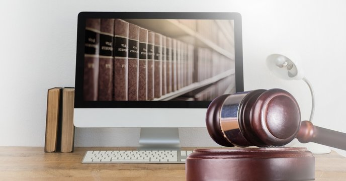 Gavel and computer with books of law and justice