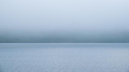 Icelandic fjord coastline in the fog
