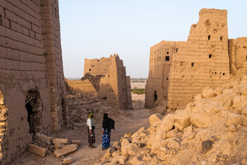 Fotobehang Midden Oosten Ruined multi-storey buildings made of mud in the district of Marib, Yemen