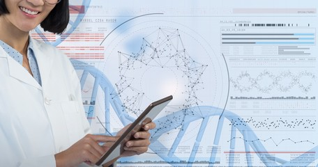 Composite image of doctor using digital tablet against white
