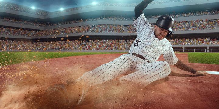 Baseball runner slide to the second base on professional baseball stadium