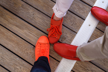 Three different pair of red shoes