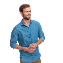 smiling casual man with palms together looks to side