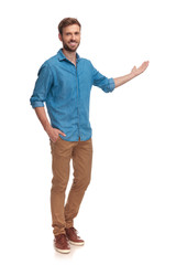 full body picture of a young casual man presenting
