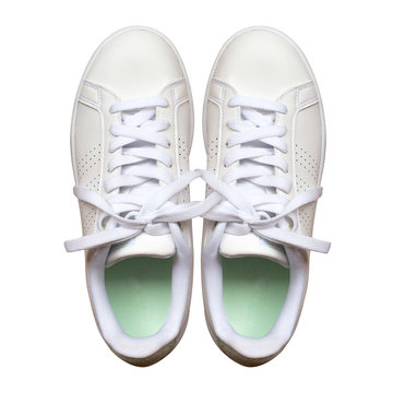 White sneakers isolated on white background. Objects with clipping path. Top view