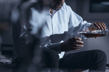 Close-up of businessman drinking alcohol