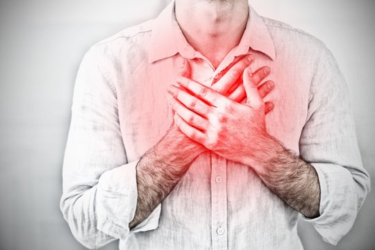Composite image of mid section of a man with chest pain
