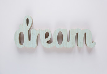 Dream - inspirational word at pastel pink background, typography for poster, t-shirt or card. flat lay, copyspace