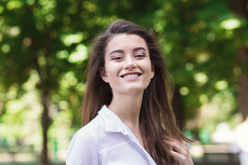 Portrait of beautiful young smiling woman outdoors
