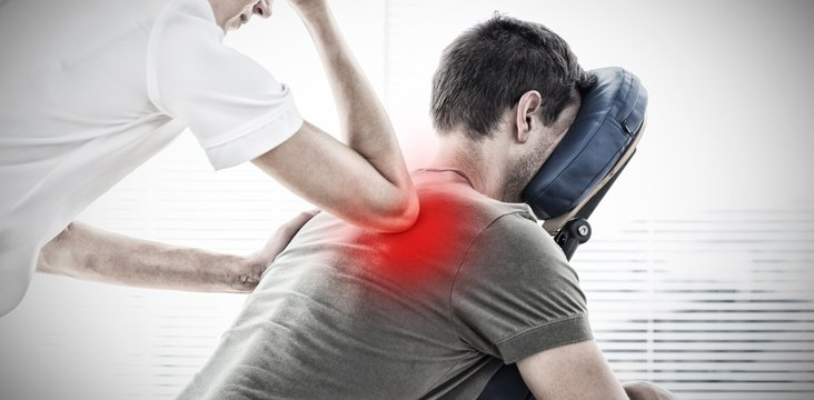 Composite image of therapist giving back massage to man