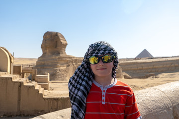 A boy in keffiyeh left alone near Sphinx, Giza, Egypt.