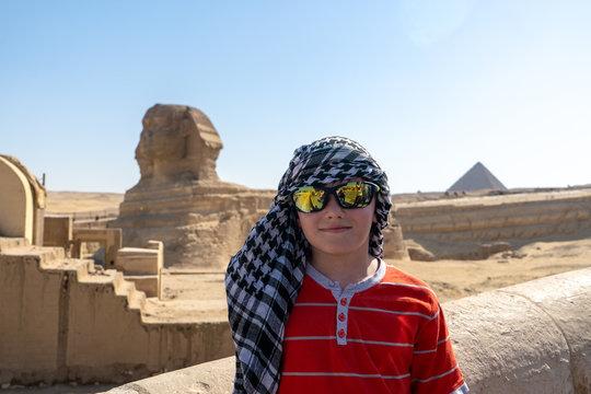 A boy in keffiyeh left alone near Sphinx, Giza, Egypt.