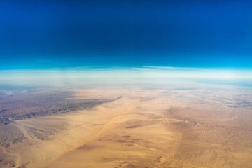 Egypt view from the airplane desert mountains.