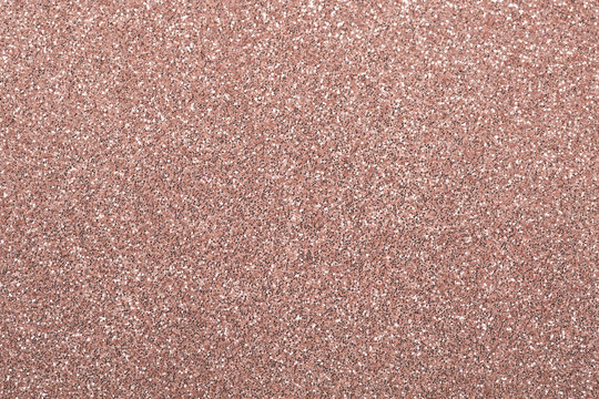Rose gold abstract glitter background