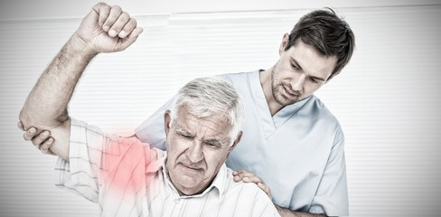 Composite image of male physiotherapist assisting senior man to