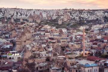 Goreme, Cappadocia, Turkey on sunset. Famous center of balloon fligths. toned picture