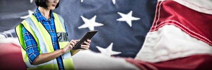 Composite image of female architect using digital tablet