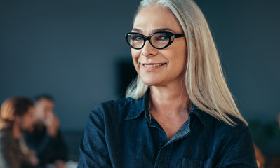 Smiling mature business woman in office