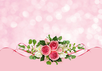 Pink roses, freesia flowers, eucalyptus leaves and satin ribbons