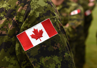 Canada patch flag on soldiers arm. Canadian troops