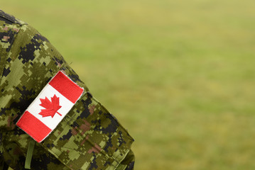 Canada patch flag on soldiers arm. Canadian troops Fototapete