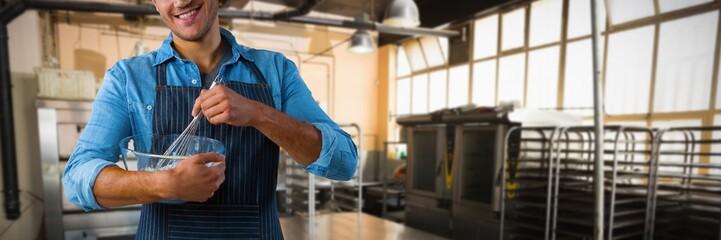 Composite image of male waiter preparing food
