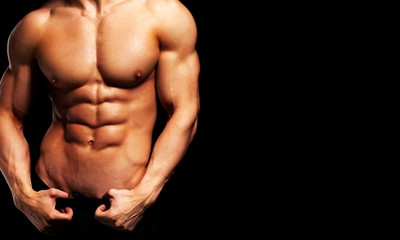 Close up of perfect male body isolated on black background with Wall mural