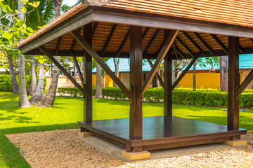 beautiful wooden gazebo in tropical nature in Thailand