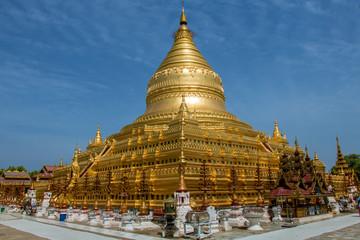 Garden Poster Temple A circular gold leaf-gilded stupa at Buddhist temple The Shwezigon Pagoda or Shwezigon Paya, Nyaung-U, Bagan Myanmar.