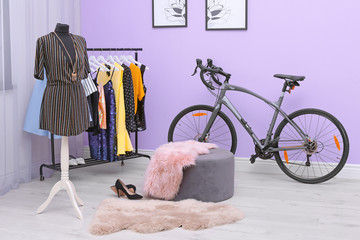 Modern bicycle in stylish dressing room interior