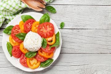 Caprese salad with tomatoes, basil and mozzarella