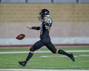 Football player kicking the ball during a game