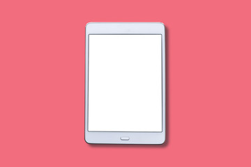 A white tablet with a blank screen on a red background.