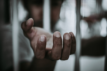 Hands of men desperate to catch the iron prison,prisoner concept,thailand people,Hope to be free.
