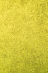 Yellow patterned surface of velvet fabric on top. Texture of artificial cloth