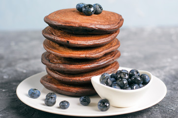 Chocolate Pancakes with Blueberry on grey background, Homemade Dessert, Sweet Breakfast