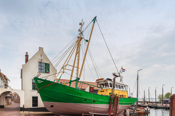 Old fishing boat docked in the Dutch village of Urk