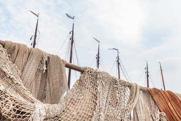 Old fishing nets in the harbor of the Dutch village of Urk