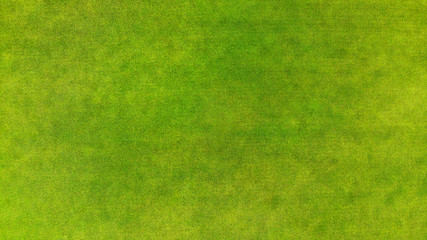 Aerial. View above of a green grass texture background.