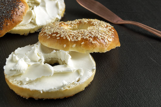 bagels with cream cheese. on black background.