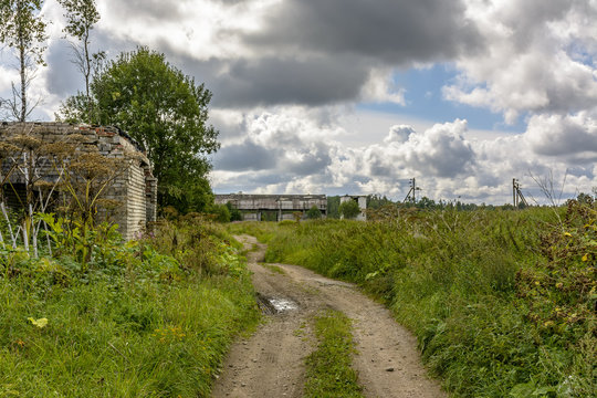 Abandoned agricultural buildings near the village of Muya in the Leningrad region.