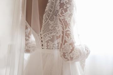 Beautiful Wedding dress and white bow isolated on white background
