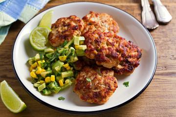 Chicken patties or  burgers with avocado corn salsa