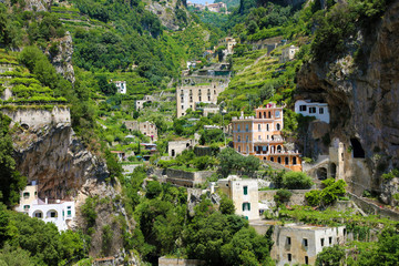 Scattered houses on rocky mountains in the nature with vineyards in Atrani village, Amalfi Coast, Italy