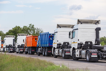 sale of trucks, semi-trailers and dump trucks