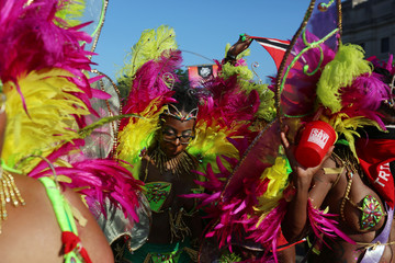 Revelers take part in the West Indian Day parade in New York